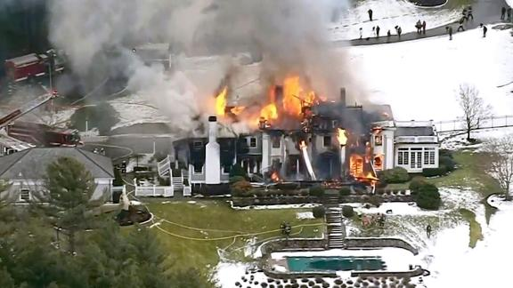 A still image from video provided by WCVB shows a mansion ablaze in Concord, Massachusetts, on December 27, 2019.