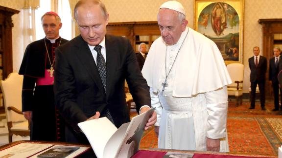 Pope Francis exchanges gifts with Putin as Putin visited Vatican City in July 2019.