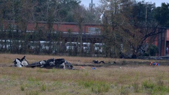 The charred wreckage of a plane crash in Lafayette, Louisiana, Saturday, December 28, 2019.