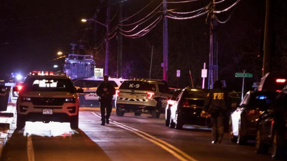 Authorities gather on a street in Monsey, N.Y., Sunday, Dec. 29, 2019, following a stabbing late Saturday during a Hanukkah celebration. A man attacked the celebration at a rabbi