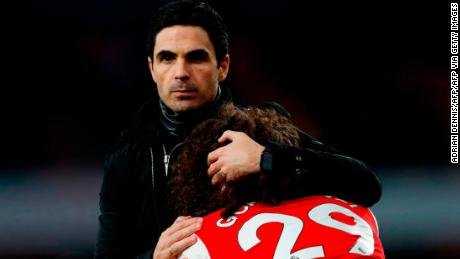 Arsenal manager Mikel Arteta hugs Matteo Guendouzi after Arsenal lost 2-1 to Chelsea.