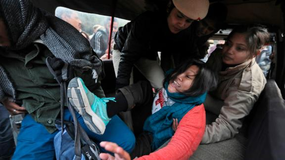 Policewomen detain a student protesting outside Uttar Pradesh Bhawan in New Delhi on Friday, December 27.