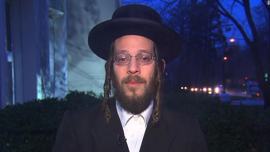 Man hurt in machete attack at Hanukkah celebration shows improvement, but prognosis still unclear