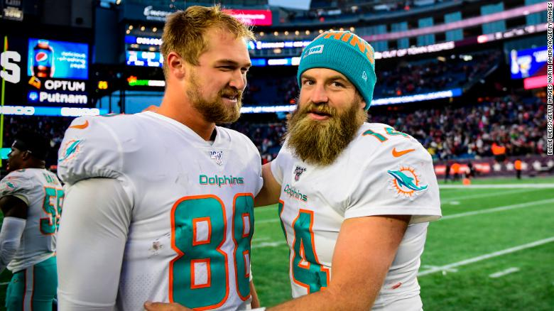 Mike Gesicki, left, and Ryan Fitzpatrick celebrate after defeating the Patriots.
