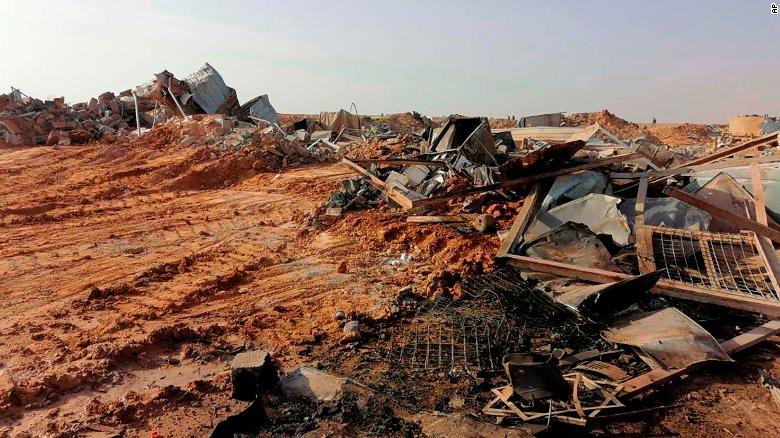 The headquarters of Kataib Hezbollah lies in ruins in the aftermath of a US airstrike in Qaim, Iraq.