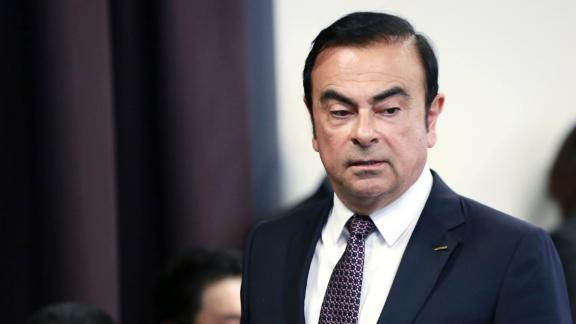 In this May 12, 2016, file photo, then Nissan Motor Co. President and CEO Carlos Ghosn arrives for a joint press conference with Mitsubishi Motors Corp. in Yokohama, near Tokyo.