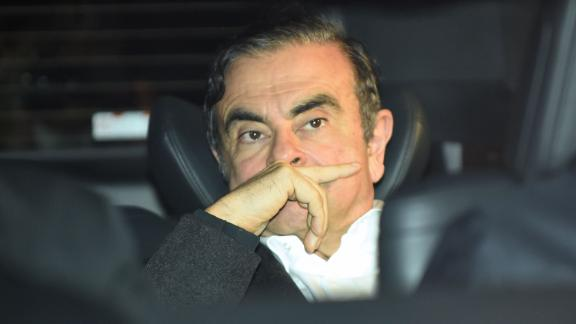 TOPSHOT - Former Nissan chairman Carlos Ghosn leaves his lawyers' offices after he was released earlier in the day from a detention centre after posting bail in Tokyo on March 6, 2019. - Ghosn posted bail of 1 billion yen (9 million USD) in cash on March 6, paving the way for his release from the Tokyo detention centre after more than three months in custody. (Photo by Kazuhiro NOGI / AFP)        (Photo credit should read KAZUHIRO NOGI/AFP via Getty Images)
