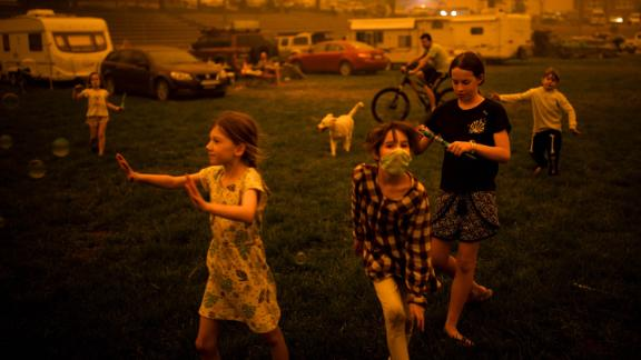 Children evacuated from areas affected by bushfires play at the showgrounds in the southern New South Wales town of Bega on December 31.