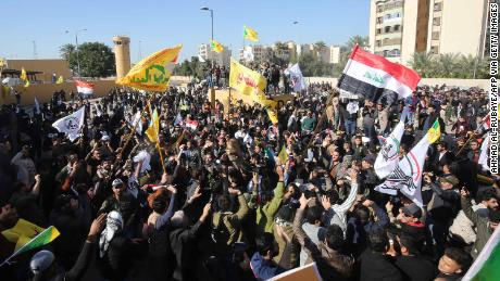 Pro-Iranian Iraqi protesters demonstrate outside the US embassy in Baghdad on Tuesday.