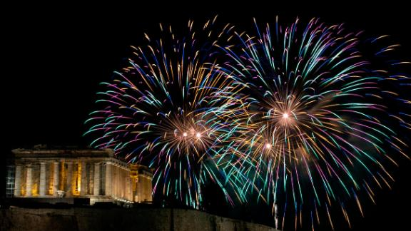 Fireworks explode over the ancient Parthenon temple on the Acropolis hill as the new year begins in Athens, Greece.
