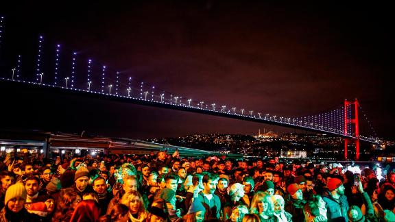 People wait for the new year in Ortakoy Square in Istanbul.