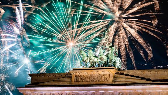 Fireworks light the sky above the Brandenburg Gate in Berlin.