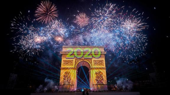 The Arc de Triomphe is engulfed in fireworks as thousands descended on the Champs Elysees to welcome the new year in Paris.