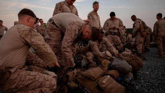 US Marines from a crisis response task force based in Kuwait prepare to deploy to Baghdad to bolster security at the embassy.