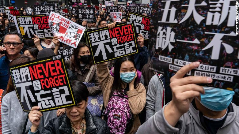 Pro-democracy supporters hold placards and shout slogans as they take part in a march during a rally on New Years Day on January 1, 2020 in Hong Kong, China.