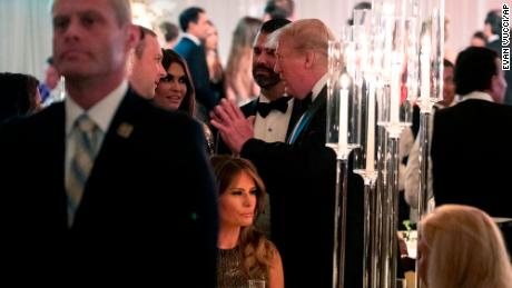 President Donald Trump, standing center, talks with guests during his New Year's Eve party at his Mar-a-Lago property, Tuesday, Dec. 31, 2019, in Palm Beach, Florida.