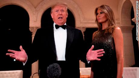 US President Donald Trump and First Lady Melania Trump speak to the press outside the grand ballroom as they arrive for a New Year's celebration at Mar-a-Lago in Palm Beach, Florida, on December 31, 2019. (Photo by JIM WATSON / AFP) (Photo by JIM WATSON/AFP via Getty Images)