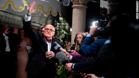 Former New York Mayor Rudy Giuliani, an attorney for President Donald Trump, speaks to reporters as he arrives for a New Year's Eve party hosted by President Donald Trump at his Mar-a-Lago property, Tuesday, Dec. 31, 2019, in Palm Beach, Florida.