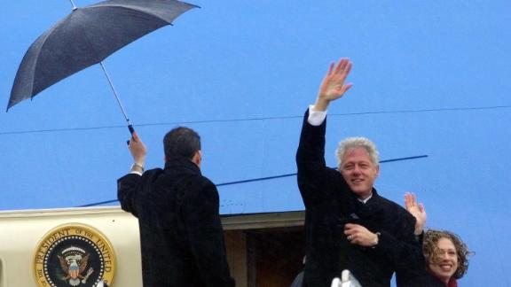 Clinton and his daughter, Chelsea, wave as they leave Washington, DC, following George W. Bush's inauguration in January 2001.