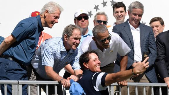 Clinton and former Presidents George W. Bush and Barack Obama pose for a selfie with golfer Phil Mickelson during the Presidents Cup event in September 2017.