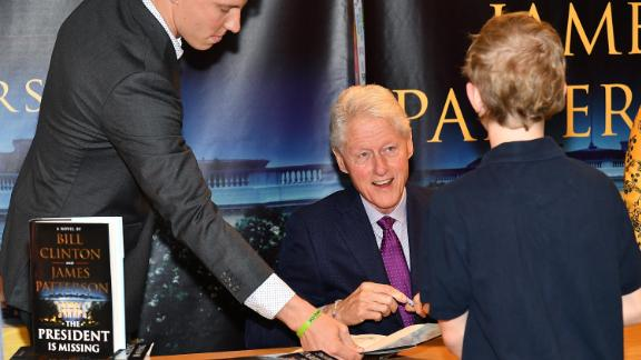 "In June 2018, Clinton signs copies of his novel ""The President Is Missing,"" which he co-wrote with James Patterson."
