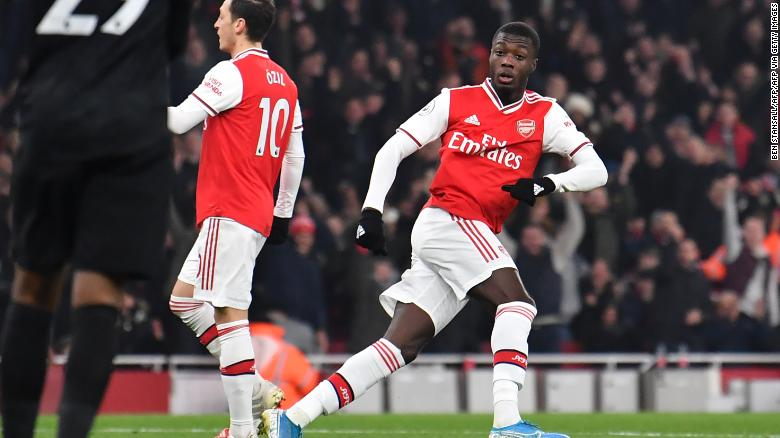 Arsenal's French-born Ivorian midfielder Nicolas Pepe turns to celebrate after scoring the opening goal of the English Premier League game against Manchester United.