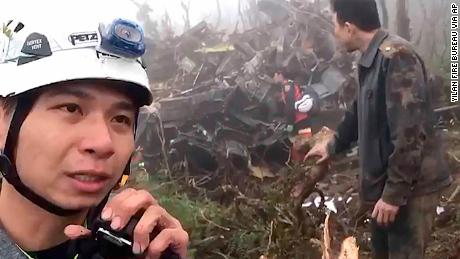 In this image made from video, emergency teams work at the crash site of a military helicopter in the mountains of Yilan, northeastern Taiwan, on Thursday, January 2, 2020.