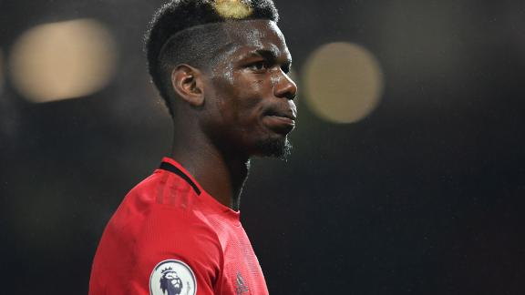 Manchester United's French midfielder Paul Pogba leaves the pitch after the English Premier League football match between Manchester United and Newcastle United at Old Trafford in Manchester, north west England, on December 26, 2019. - Manchester United won the game 4-1. (Photo by Paul ELLIS / AFP) / RESTRICTED TO EDITORIAL USE. No use with unauthorized audio, video, data, fixture lists, club/league logos or 'live' services. Online in-match use limited to 120 images. An additional 40 images may be used in extra time. No video emulation. Social media in-match use limited to 120 images. An additional 40 images may be used in extra time. No use in betting publications, games or single club/league/player publications. /  (Photo by PAUL ELLIS/AFP via Getty Images)