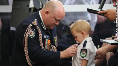A firefighter was killed in the Australia bushfires. His son received a medal to honor his father's bravery