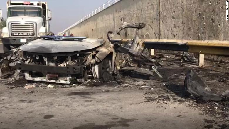 A daylight image of a vehicle hit in the US airstrike Friday.