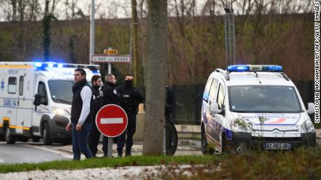 Police at the park in Villejuif, France, where the attack took place.