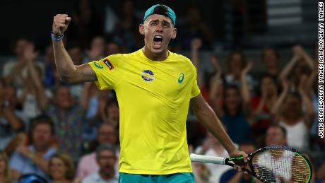 Alex de Minaur, who has pledged his support to Australia's bushfires, reacts to winning the second set against Alexander Zverev at the ATP Cup.