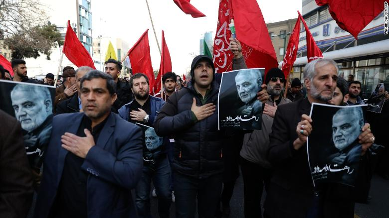 Protesters mourn the death of Qassem Soleimani in the Iranian capital, Tehran, on Friday.