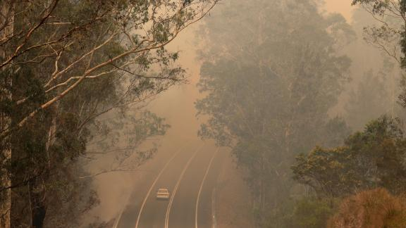 Smoke from wildfires shrouds a road near Moruya, Australia, on January 4.