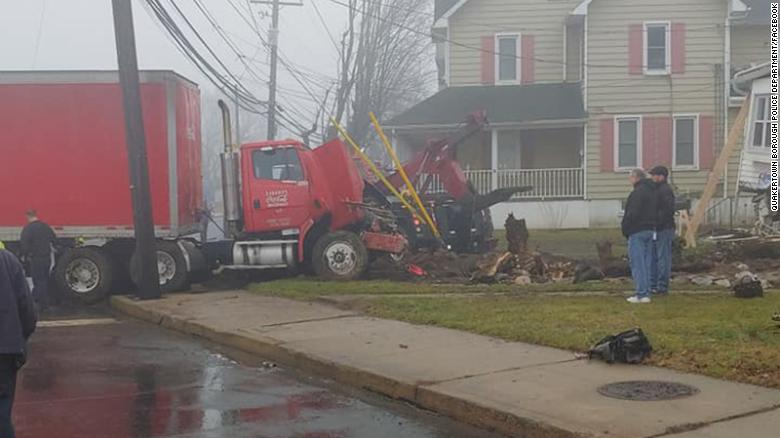 It took six hours to remove the truck from the house.