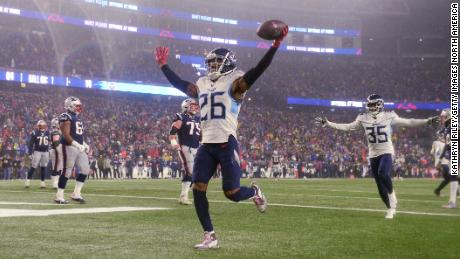 Logan Ryan of the Tennessee Titans scores a touchdown against the New England Patriots in the fourth quarter of the AFC Wild Card Playoff game.