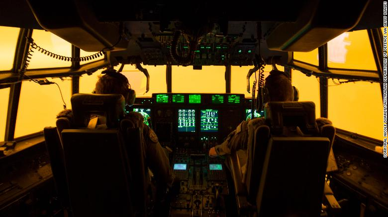 The flight deck of a C-130J Hercules is lit by the red glow of the fires below as the aircrew attempts to land in Merimbula to drop off fire and rescue crews to assist fighting the bushfires on Sunday, January 5.