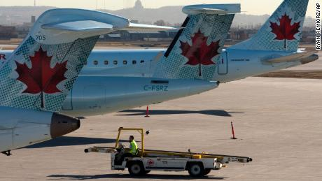 Air Canada planes sit on the tarmac at Montreal-Trudeau International Airport.