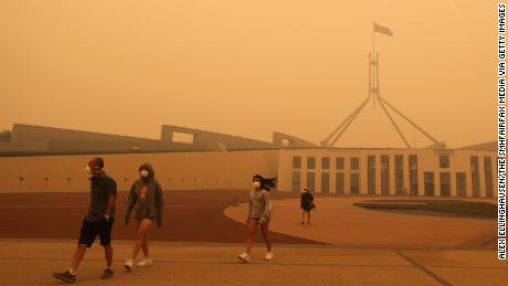 Visitors to Parliament House were forced to wear face masks after smoke from bushfires blankets Canberra in a haze on January 5.