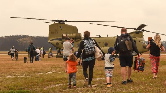 Families are evacuated by air from Mallacoota on January 5.