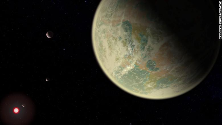 This artist's illustration shows a wet exoplanet with an oxygen atmosphere. The red sphere is the M-dwarf star the exoplanet orbits.