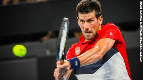 Novak Djokovic hits a return against Gael Monfils during the ATP Cup in Brisbane.
