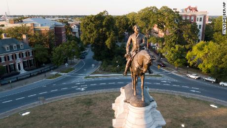 The early morning sun highlights the statue of Confederate General Robert E. Lee on Monument Avenue in Richmond, Virginia, on July 31, 2017.