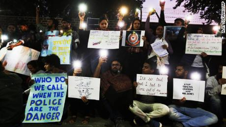 Students protest at New Delhi's Jawaharlal Nehru University on Monday, a day after masked assailants attacked students on campus.