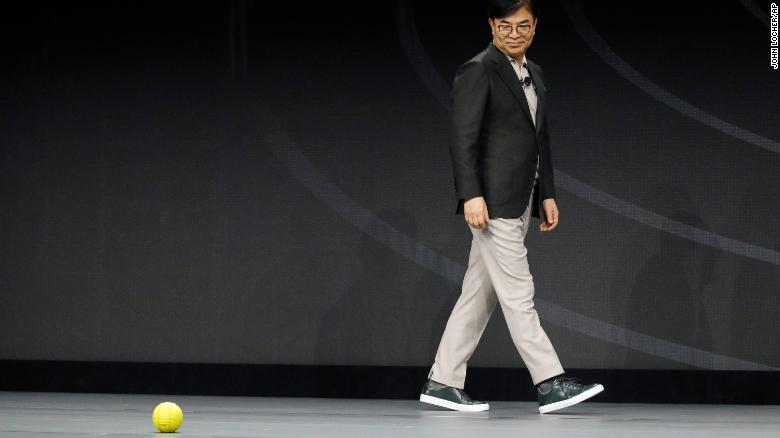 Hyun-Suk Kim, president and CEO of the Consumer Electronics Division at Samsung, demonstrates Ballie, an AI rolling robot during a Samsung keynote before the CES tech show, Monday, Jan. 6, 2020, in Las Vegas.