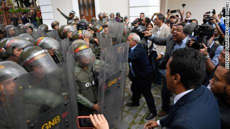 Venezuelan opposition lawmakers force their way into the National Assembly in Caracas, on January 7, 2020.