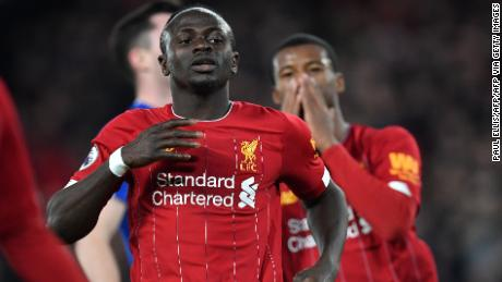 Mane (L) reacts after failing to score during the English Premier League football match between Liverpool and Everton at Anfield on December 4, 2019.