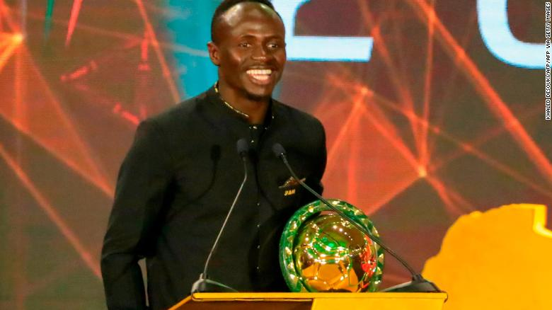 Mane pictured receiving his  Player of the Year award during the 2019 CAF Awards.