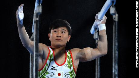 Takeru Kitazono prepares for the parallel bars event at the 2018 Youth Olympics.