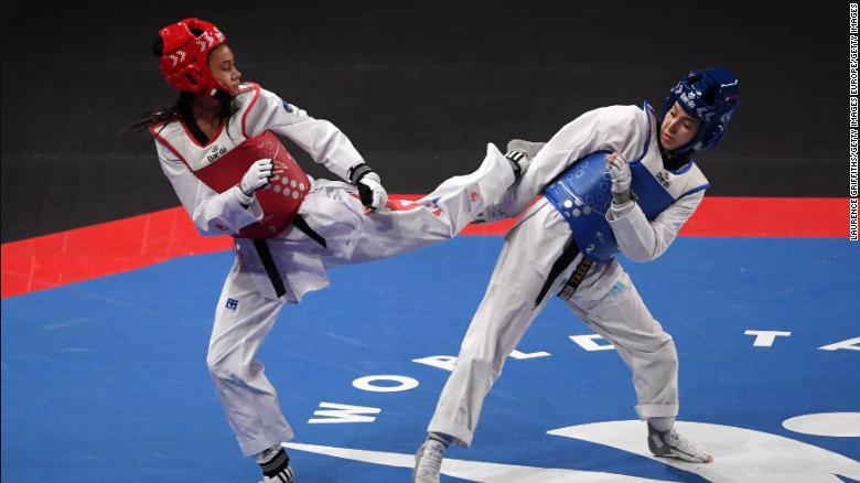 Aaliyah Powell (right) dodges a kick from Morocco's Oumaima El Bouchti on her way to winning bantamweight gold at the 2019 World Taekwondo Championships.